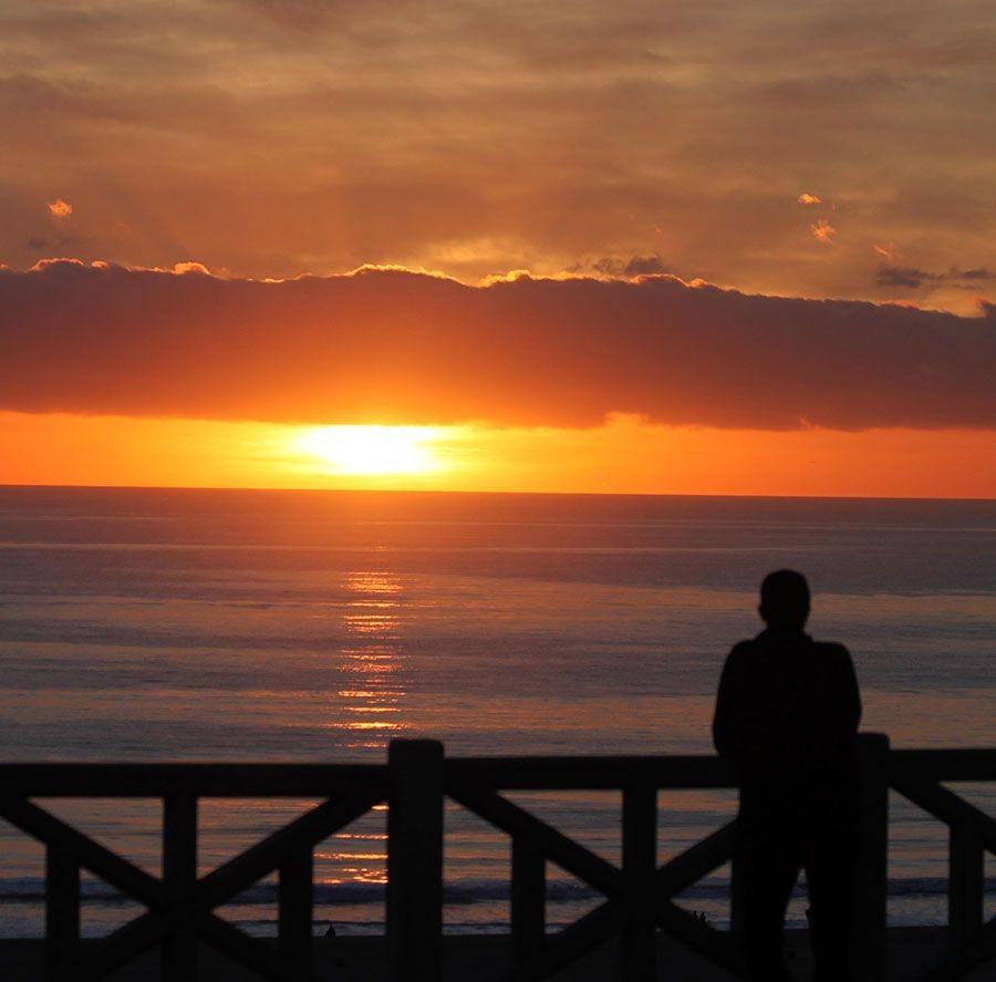 man-looking-at-sunset